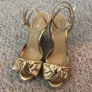 BNIB Michael Kors leather wedges in gold size 9